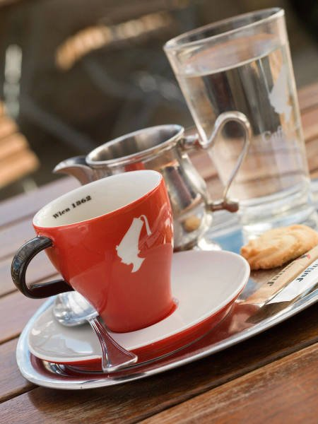 julius meinl cup of coffee and glass of water