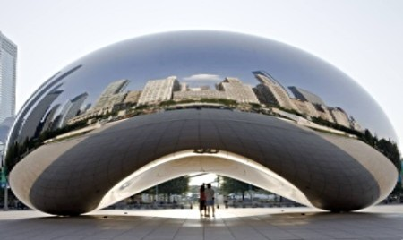 Cloud Gate reflecting the city skyline in Millennium Park Chicago